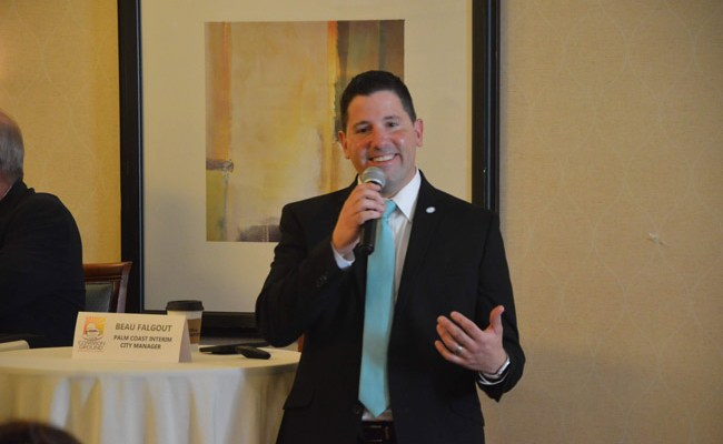 'Of course I'm on the longest job interview known to man,' Palm Coast Interim Manager Beau Falgout told a Chamber audience three weeks ago. He's also been the clear favorite for the permanent job as the city council has strained to project to other candidates that they still have a shot at the job. Falgout was not at Tuesday's council meeting discussing the next round in the search. (© FlaglerLive)