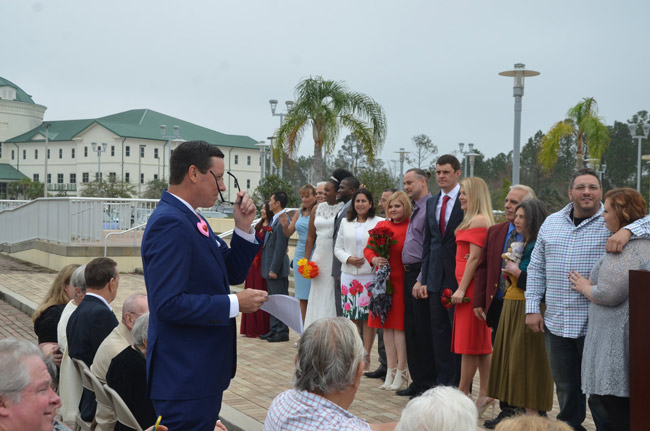 Clerk of Court Tom Bexley, left, preparing to marry 16 couples at last year's Valentine's Day ceremony on the courthouse steps. (© FlaglerLive)