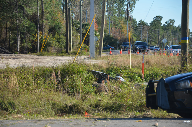 The motorcycle swerved off U.S. 1 where the traffic cones are, and struck a road sign and a culvert before going airborne. (c FlaglerLive)