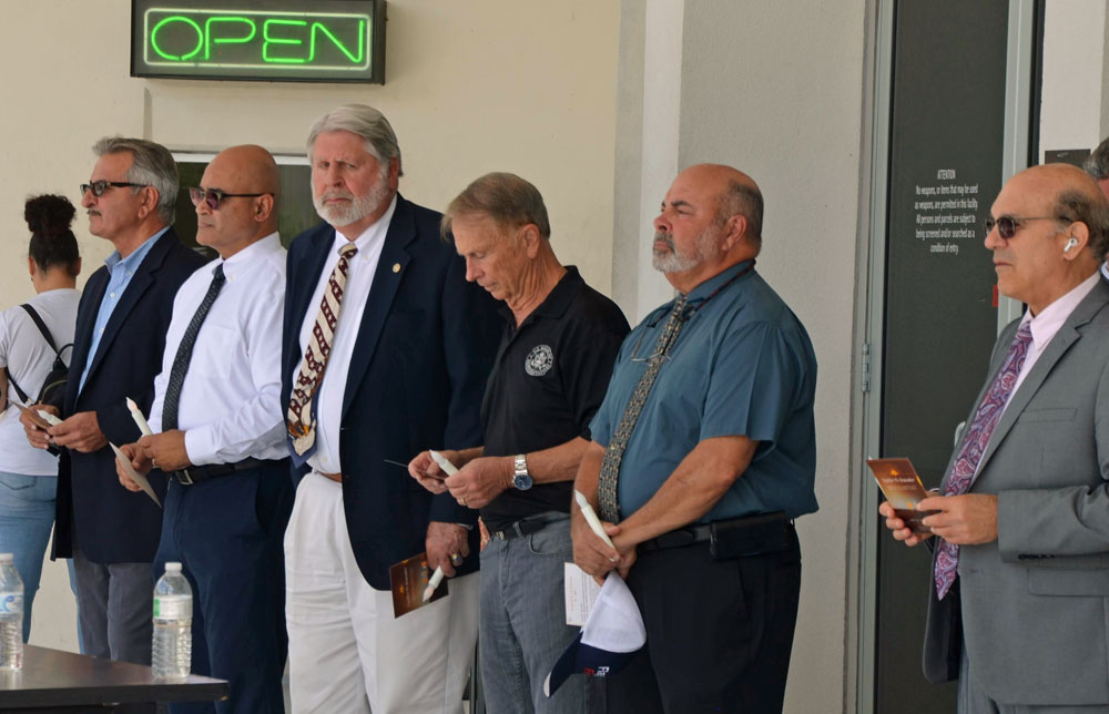 Jerry Cameron, fourth from right, at a recent county event, standing next to Jorge Salinas, the chief of staff and incoming interim county administrator. Cameron is ending his tenure in that role after two years and four months. (© FlaglerLive)