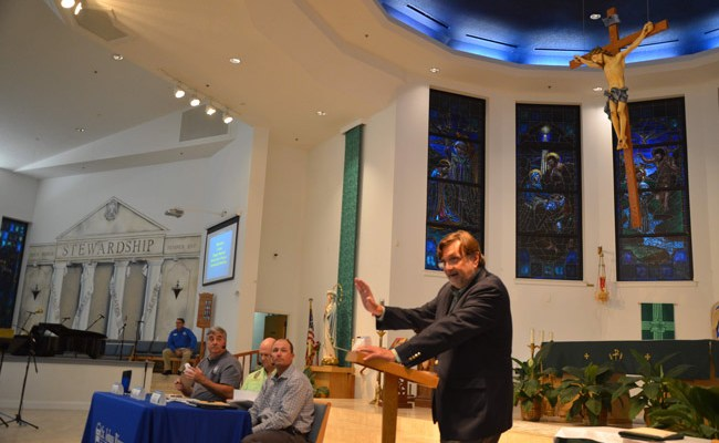 Clay Henderson, the environmental attorney, was the St. Johns River Water Management District's chosen moderator at Wednesday's public-input meeting on a wetlands restoration project. The meeting took place at Santa Maria del Mar Catholic Church. (© FlaglerLive)