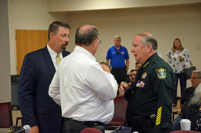 Flagler County Sheriff Rick Staly, right, with County Commission Chairman Greg Hansen, center, and County Administrator Craig Coffey before today's meeting on the Sheriff's Operations Center. (© FlaglerLive)