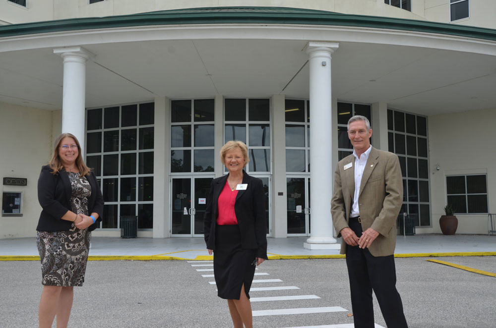 From left, Supervisor of Elections Kaiti Lenhart, Tax Collector Suzanne Johnston, and Property Appraiser Jay Gardner, shortly after they'd been re-elected at midday today. (© FlaglerLive)