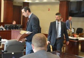 The prosecution team: Assistant State Prosecutors Jason Lewis, left, and Joe LeDonne, with Mark Lewis, seated and his back to the camera. (© FlaglerLive)