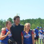 Emily Warren and Sadie Schnell with Gov. DeSantis after catching the first pitches. (© FlaglerLive)