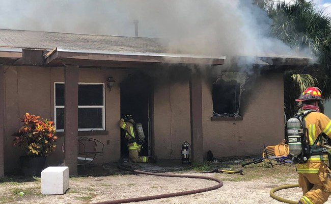 The duplex at 502 East Drain Street as firefighters worked to put it out. (Flagler County Professional Firefighters Local 4337)