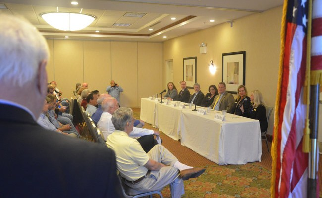 Ed Fuller of the Flagler Palm Coast Forum hosted what may be the only judges' forum of the 2018 election season Tuesday evening at Palm Coast's Hilton Garden Inn. Some 80 to 90 people attended the event, not counting bailiffs. (© FlaglerLive)
