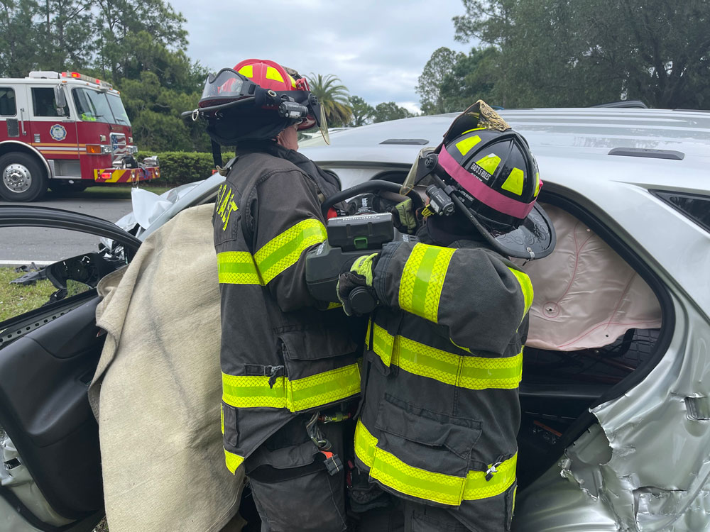 Palm Coast Fire Department crews in the middle of one of the extrications at today's crash. (Palm Coast Fire Department)