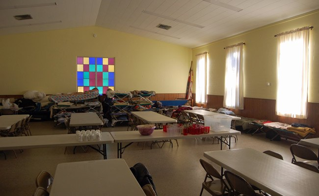 Cots and tables at Fellowship Hall, at Bunnell's United Methodist Church, which becomes a cold-weather shelter for the homeless on certain nights. (© FlaglerLive)