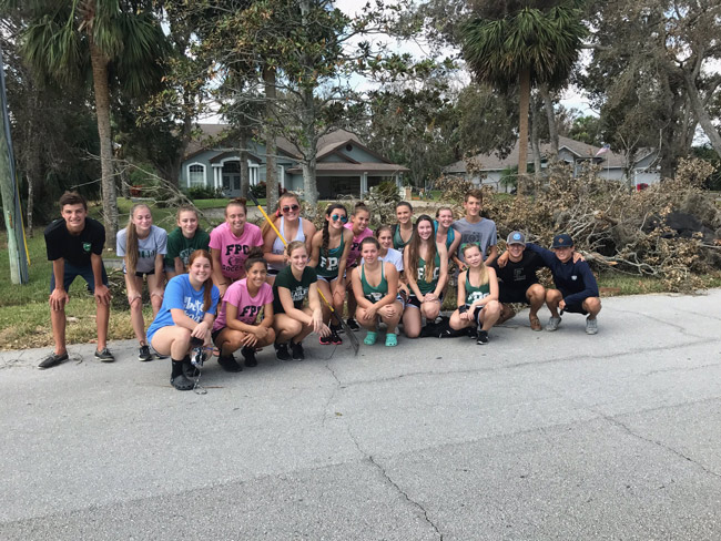 Give 'em a cheer: the Flagler Palm Coast High School cheer squad, after helping out in Flagler Beach Sunday morning. (Twitter)