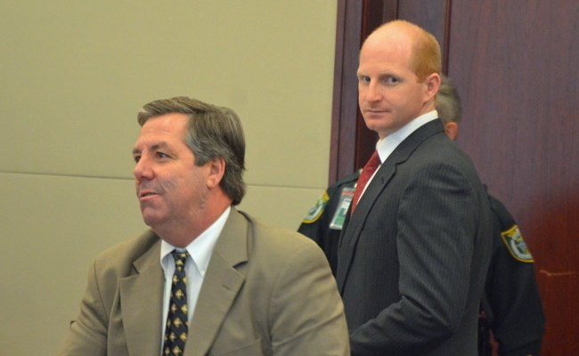 Grant Geiger, right, with his attorney, William Bookhammer, three hours before he heard the verdict against him. (© FlaglerLive)