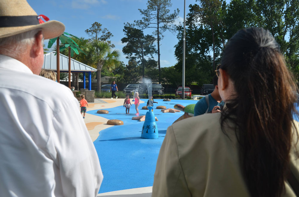 Milissa Holland, right, with County Commissioner Dave Sullivan, at her last public event as mayor, at Palm Coast's newly opened splash pad in mid-May. (© FlaglerLive)