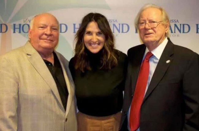Milissa Holland with Jon Netts and Jim Canfield, the three Palm Coast mayors.