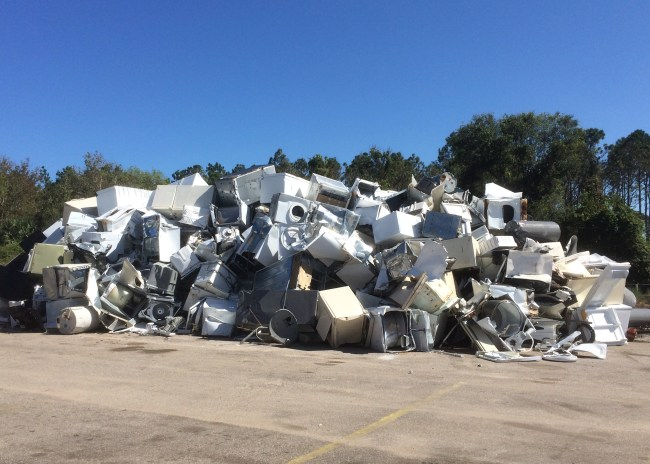 At Flagler Beach's sanitation facility, a mound about 10 to 12 feet high has risen, a mass of residents' appliances ruined by Hurricane Irma flooding. Click on the image for larger view. (© FlaglerLive)
