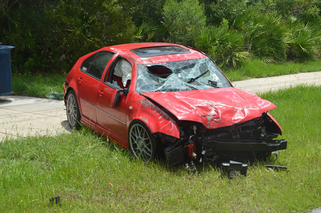 The Volkswagen Jetta after the crash on Seminole Woods Boulevard at noon. (© FlaglerLive)
