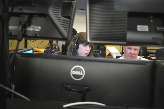 Veteran 911 dispatcher Josie Gannon trained Sheriff Rick Staly for four hours at Flagler County's 911 center Wednesday. It was not a quiet shift. Click on the image for larger view. (© FlaglerLive)