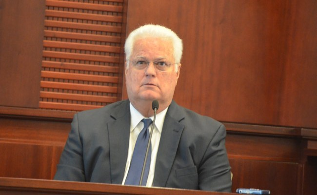 As Florida Secretary of State Ken Detzner, in office since 2012, sat in the witness box today, a Flagler County jury heard a recording of ex-Elections Supervisor Kimberle Weeks call Detzner and one of his his attorneys names. Detzner listened in stunned silence. (© FlaglerLive)