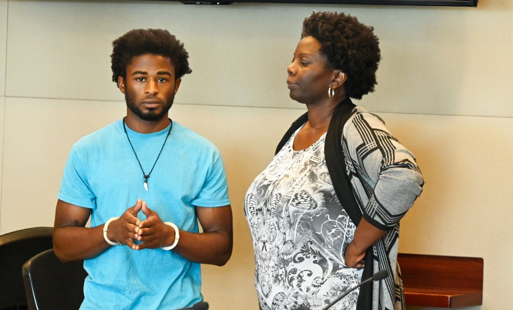 """In the words of Mario Balotelli: """"Why always me?"""" L'Darius Smith with his attorney, Assistant Public Defender Regina Nunnally. (© FlaglerLive)"""