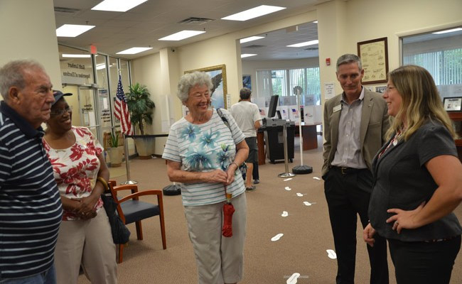 Supervisor of Elections Kaiti Lenhart, right, speaking with the last group of voters--and Jay Gardner, the property appraiser--at the end of a day-long mock election that tested new equipment and introduced voters to new voting machines and to the innards of the elections office on Tuesday. (© FlaglerLive)