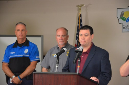 Flagler Emergency Management Chief Jonathan Lord at this morning's press conference, with Sheriff Rick Staly and Flagler Beach Police Chief Matt Doughney. (© FlaglerLive)