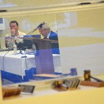 Martin Murphy, right, reflected in a commission chamber window during his interview with Bunnell's commissioners last month. His contractual demands are not resonating with commissioners. (© FlaglerLive)