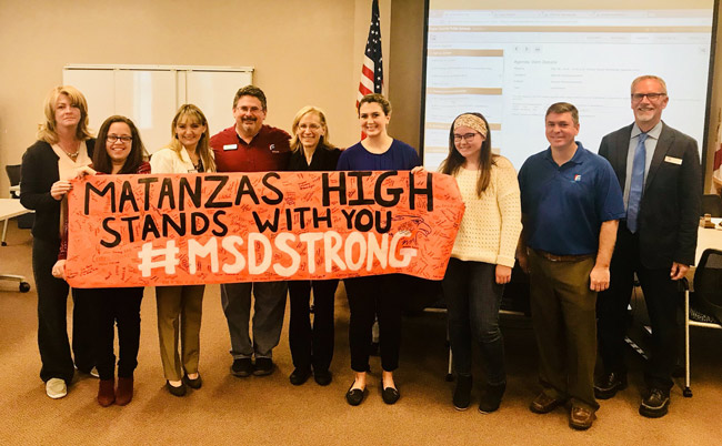 'It's a solid day when some of the greatest students of all time attend the board workshop,' Superintendent Jim Tager tweeted on Tuesday after Matanzas High students Alicia Bermudez and Kelsey Sweeney joined the school board to hold up a banner their school had prepared for the students at Marjorie Stoneman Douglas High in Parkland.