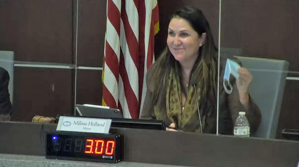 Mayor Milissa Holland, bidding masks farewell this evening.
