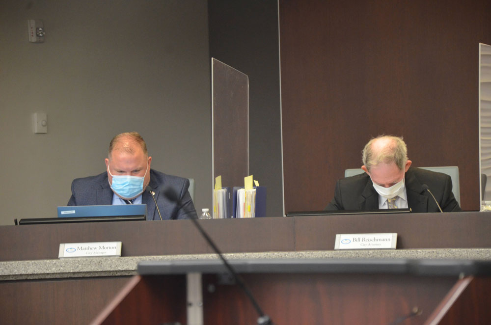 City Manager Matt Morton, left, and City Attorney Bill Reischmann, who's had a few occasions for anguish over council members' exchanges since November. (© FlaglerLive)