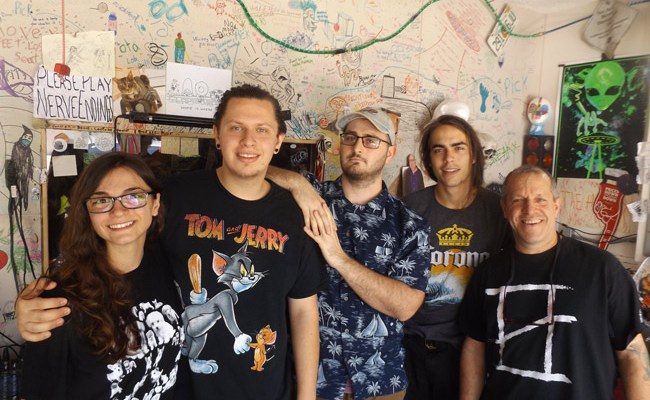 """Pictured in The Ned's recording studio and rehearsal space in Palm Coast are, from left: Marissa LiCausi of the band Flora LiCrame, The Ned drummer Joe Gardella, The Ned PR/booking manager Justyn Perry, The Ned singer-guitarist Trace George, and The Ned manager Artie """"Papa Ned"""" Gardella. (© FlaglerLive)"""
