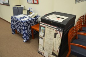 An old voting machine--the sort voters are familiar with--next to other museum pieces, including the Kennedy-Nixon election ballot, and ballots from the hanging chad era. Click on the image for larger view. (© FlaglerLive)