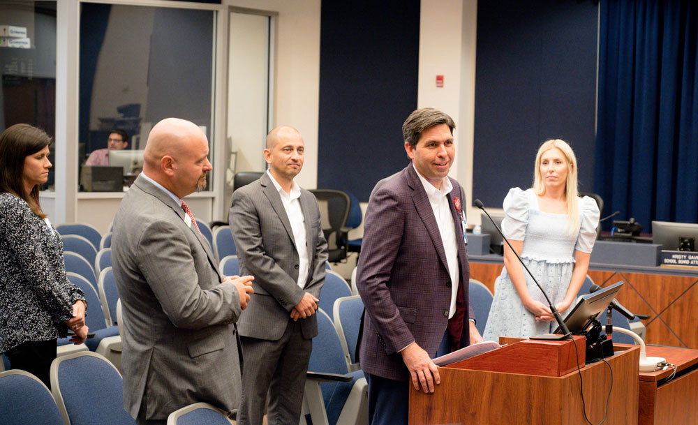 AdventHealth Central Region CEO David Ottati, a former CEO of the local hospital, addressing the school board Tuesday evening, with, from left, AdventHealth's Lauren Dye, Flagler Education Foundation Executive Director Joe Rizzo, AdventHealth Palm COast COO Wally de Aquino, and Sp[orts Marketing and Strategic Partnerships Director Anna Donaldson. (Flagler Schools)