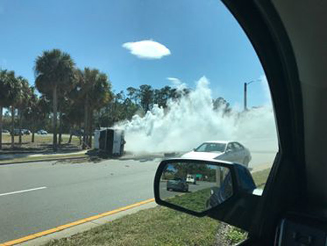 The pick-up truck that law enforcement was chasing overturned on Palm Coast Parkway near I-95, and its occupants fled. (© FlaglerLive)