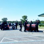 Deputy Paul Luciano's coffin as pallbearers approached First Baptist Church in Bunnell for this morning's service. (© FlaglerLive via FCSO video)