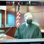 Flagler County Circuit Judge Terence Perkins holding a set of hearings by zoom recently: he presided from his courtroom, defendants were connected by video from the jail, lawyers and others by Zoom. (© FlaglerLive)