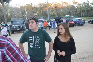 Tyler Perry, left, who organized the march, and Alyssa Santore, a member of the FPC student government, speaking with Matt Bruce of the News-Journal before the march. Click on the image for larger view. (© FlaglerLive)