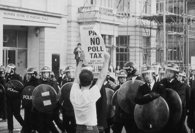 Anti-poll tax demonstrators confront police in London, 1990. A measure in Florida has been likened to a new poll tax. (Shutterstock)