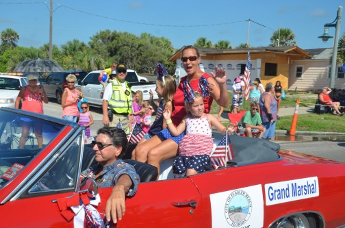 Mayor Linda Provencher as Grand Marshal of Flagler Beach's 2016 July 4 parade. She was re-elected without opposition. Click on the image for larger view. (© FlaglerLive)