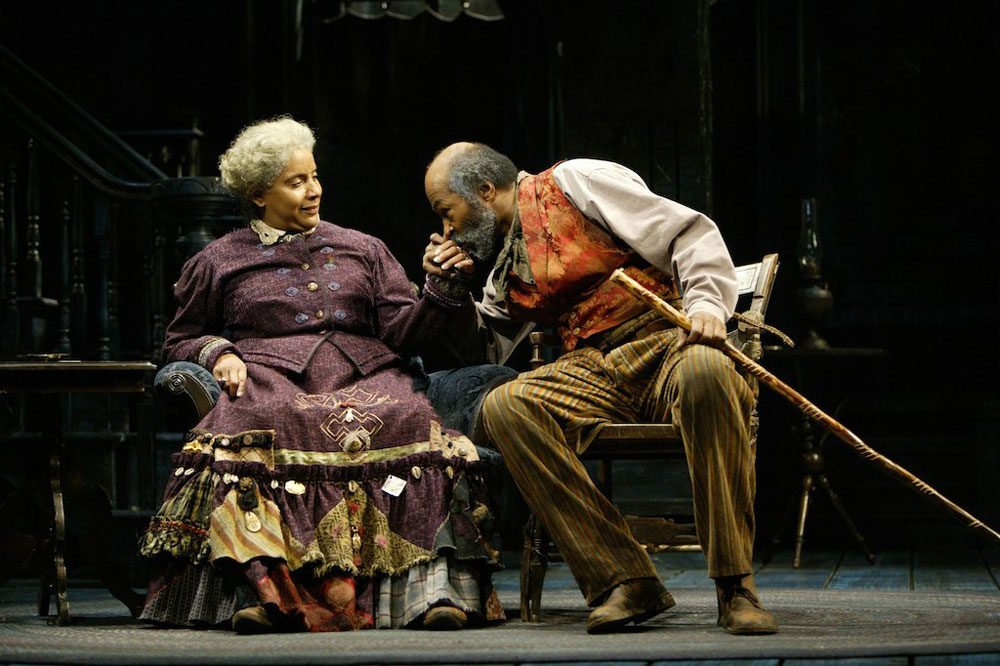 """Phylicia Rashad as Aunt Ester and Anthony Chisholm as Solly Two Kings in a production of August Wilson's """"Gem of the Ocean,"""" staged by the Huntington Theatre Company in Boston in 2005. (T. Charles Erickson)"""