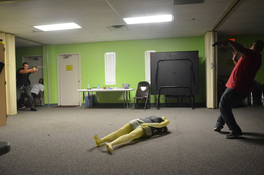 """A Flagler County Sheriff's deputy """"shoots"""" an active shooter (with blanks) during a training session two years ago. (© FlaglerLive)"""