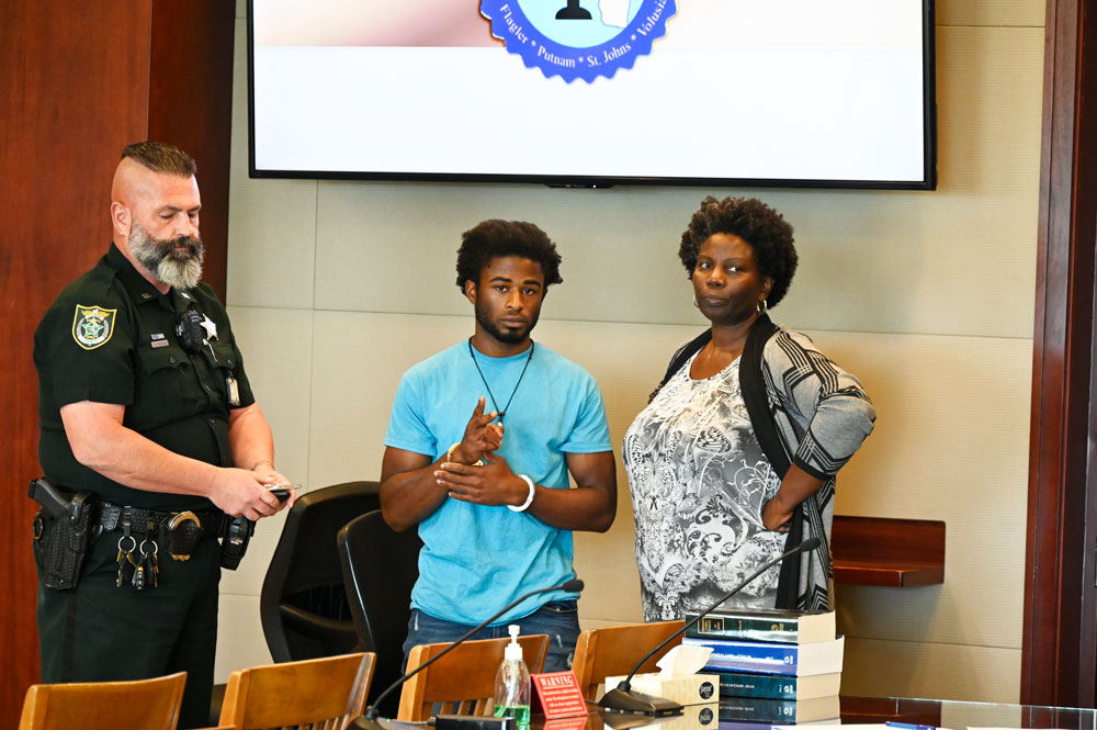 L'Darius Smith after the verdict with his attorney, Assistant Public Defender Regina Nunnally, and Greg Weston, a sheriff's deputy. (© FlaglerLive)