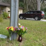 A roadside memorial for Logan Goodman went up soon after he was killed in a motorcycle crash last January in Palm Coast's Woodlands. (© FlaglerLive)