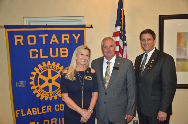 The Flagler County Rotary Club Thursday evening held its installation banquet as now Past-President Jim Troiano's tenure came to an end, and that of Tracy Loftus, center, began. Cindy Kiel Evans is president-elect. The Rotary provided $12,000 in scholarships under Troiano's tenure, and is putting renewed emphasis on membership and fund-raising this year, as with a gala that will precede the annual opening of its popular Fantasy Lights at Town Center's Central Park in the run-up to Christmas and New Year's. Troiano, who had been part of former Sheriff Jim Manfre's administration, is now the intergovernmental coordinator for the St. Johns River Water Management District, which includes Flagler County. Loftus is with Tom Gibbs Chevrolet, and Kiel Evans is with State Farms. (© FlaglerLive)