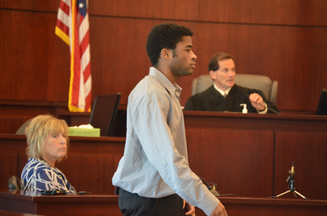 L'Darius Smith will get to walk, as he did off the witness stand this morning, with Circuit Judge Dennis Craig in the background. (c FlaglerLive)