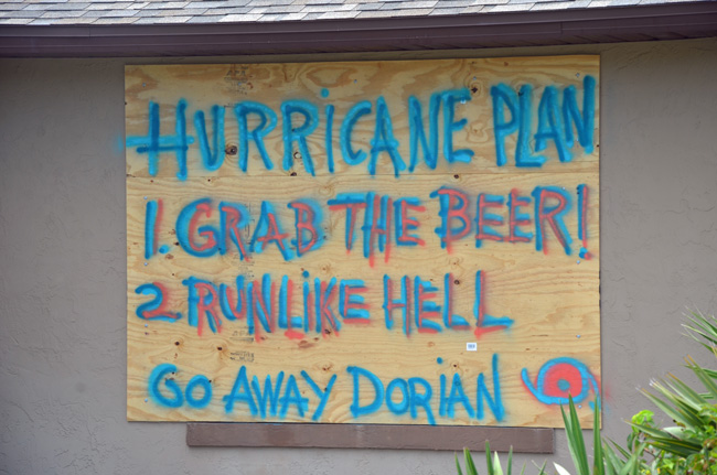 A boarded up house's message to Hurricane Dorian at the south end of Flagler Beach, near the Intracoastal, a neighborhood battered by Irma's floodwaters two years ago. (© FlaglerLive)