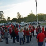 Just before sun-up at Indian Trails Middle School, walk-in participants, including teachers, administratorsm service employees and students, gathered at the flagpole, as they would at all nine of the county's traditional public schools this morning. (© FlaglerLive)