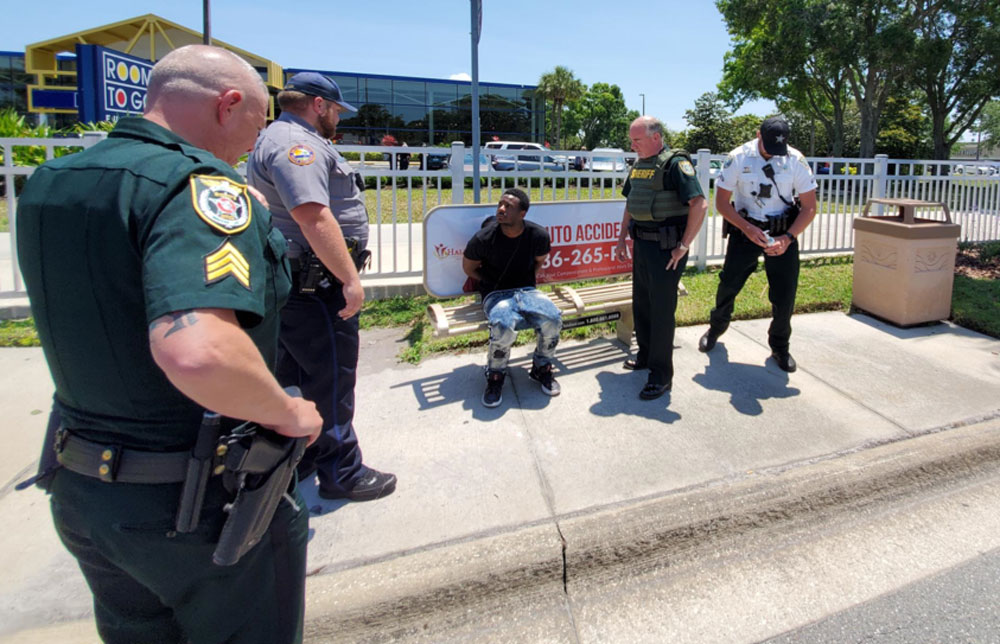 The suspect after his arrest, with Sheriff Staly to the right. (FCSO)