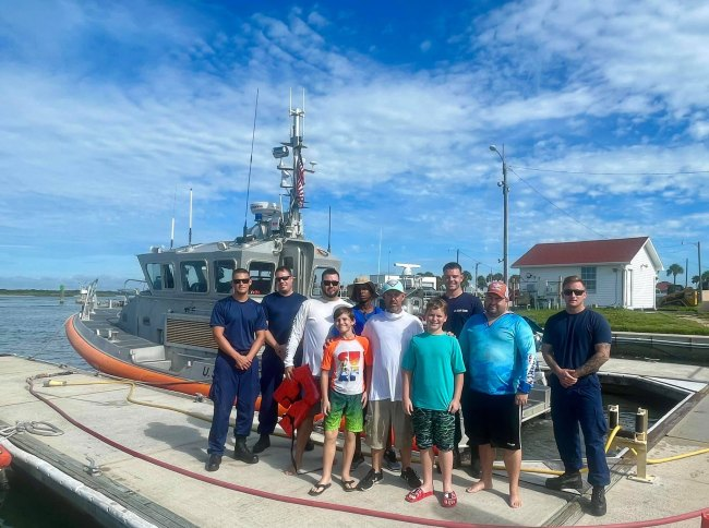 The Six and the Coast Guard crew. (Jason Arnett)