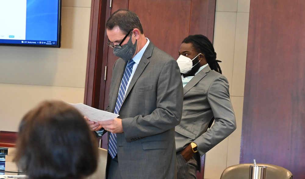 John Hager, left, Deviaun Toler's defense attorney, said Toler had himself been subjected to corporal punishment when he was a child, and was doing the same to his 20-month-old child. The 20 month old was hospitalized for three weeks in critical condition with a skull fracture and a burn to the arm, among other injuries. (© FlaglerLive)