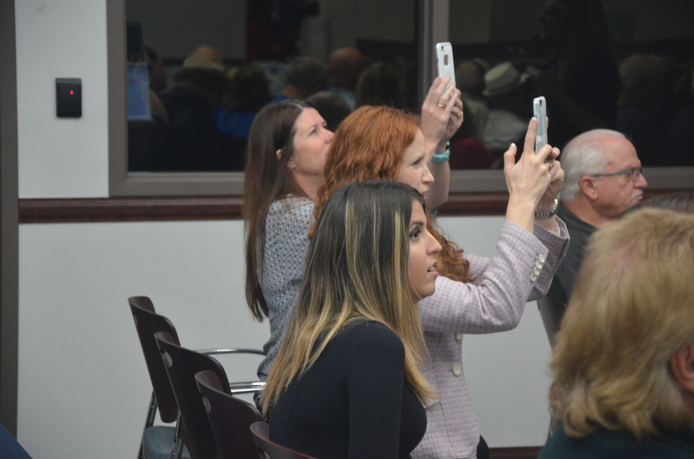 Tori Holman at her mother's swearing-in as mayor on Nov. 15, 2016, three years before her liver transplant but well into her illness. (© FlaglerLive)