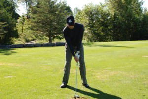 At our golf school we like to get your lead ear in line with your hands and the back of the golf ball. We also like to see the lead ear at the back of the ball at impact. If your head moves forward during your downswing you'll hit down on the ball too much resulting in a lower than optimal ball flight.
